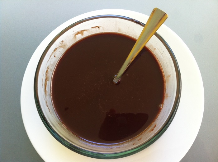 Melted cacao butter, coconut oil and raw cacao powder